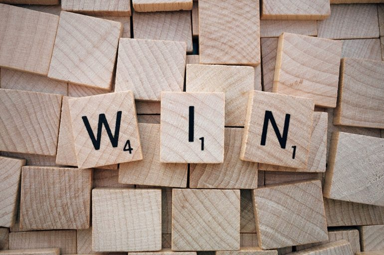 Wooden blocks spelling WIN