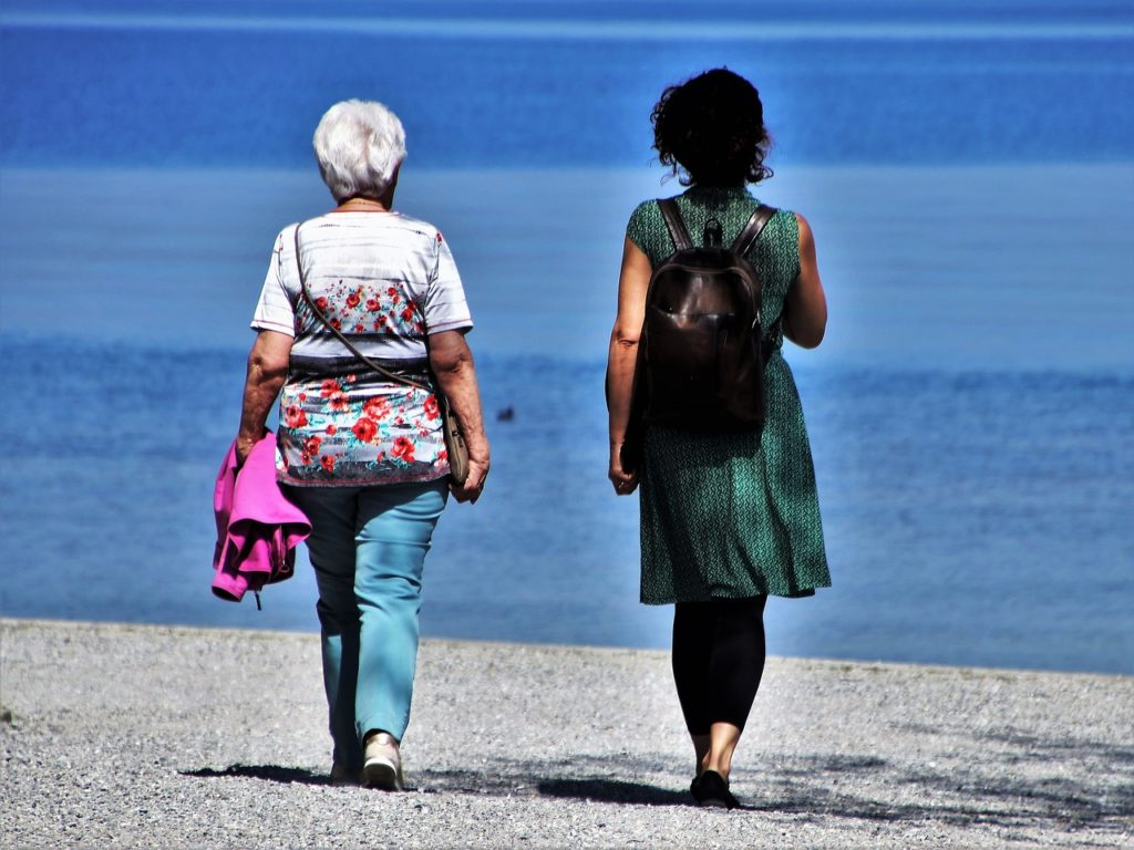 women menopause walking on beach