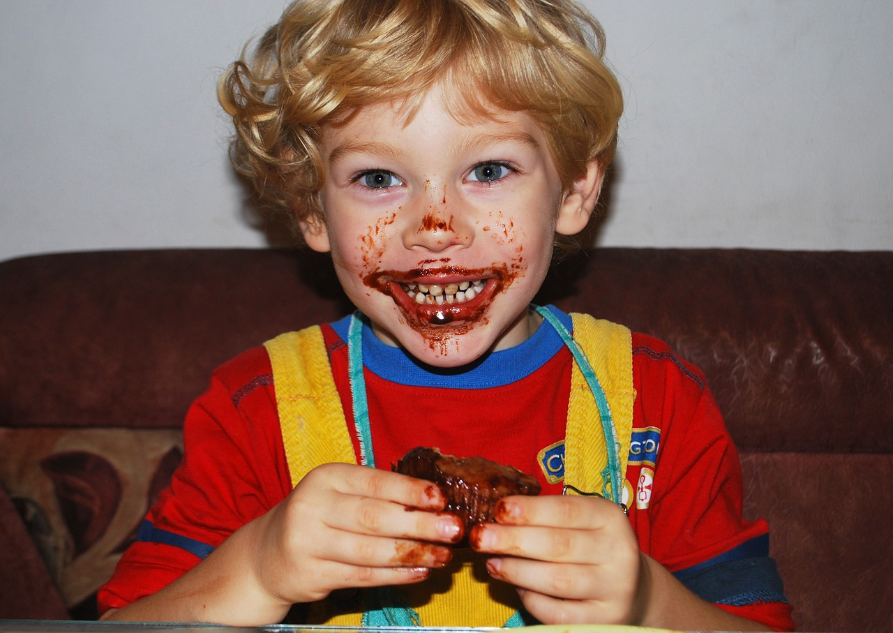 child with chocolate spread on face