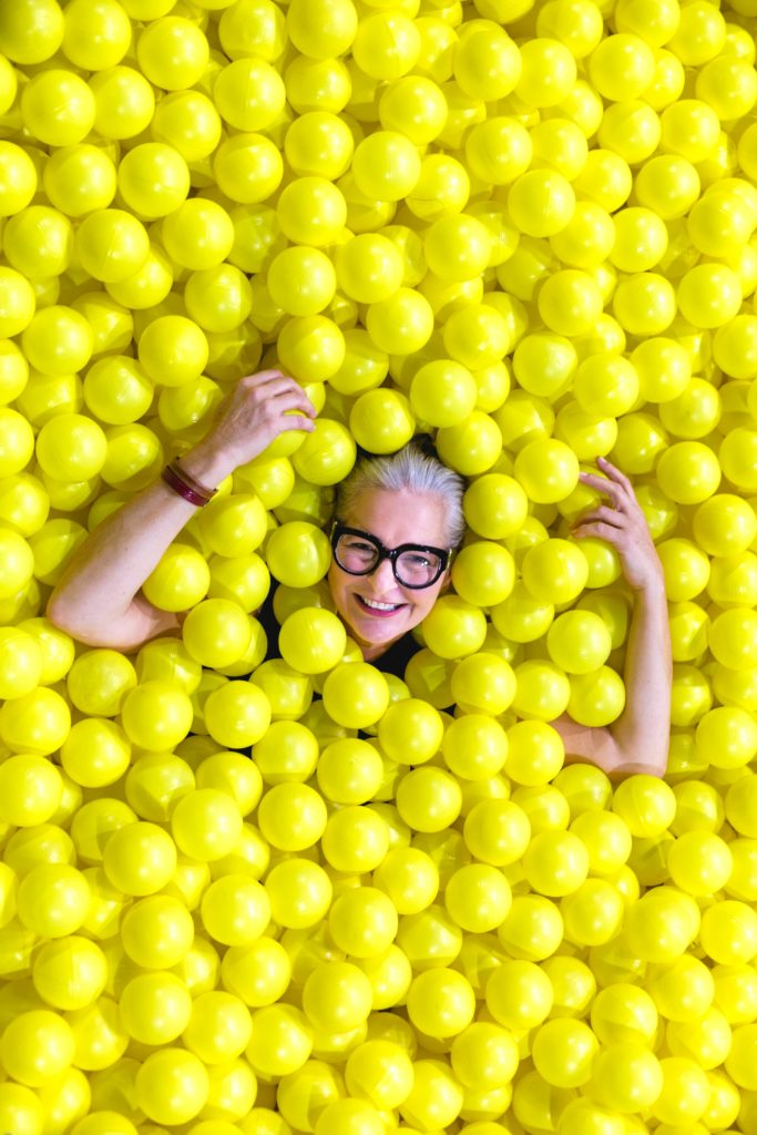 older woman in a ball pit