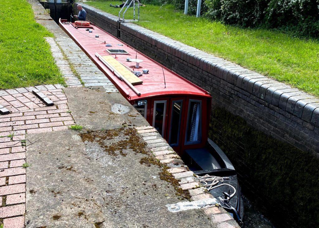 A narrowboat transiting a lock