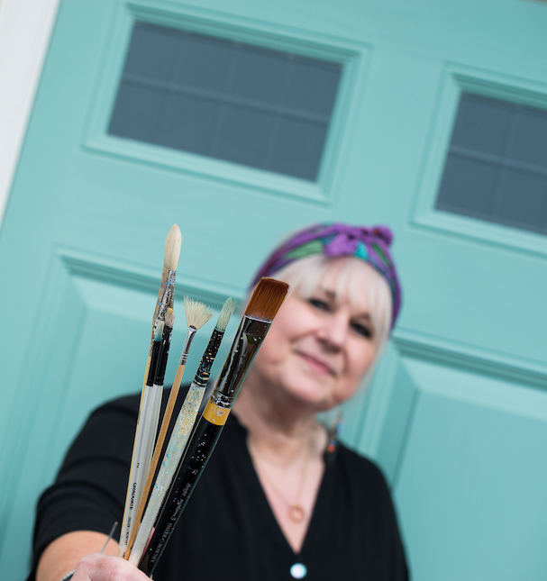Mandy by a door with her brushes